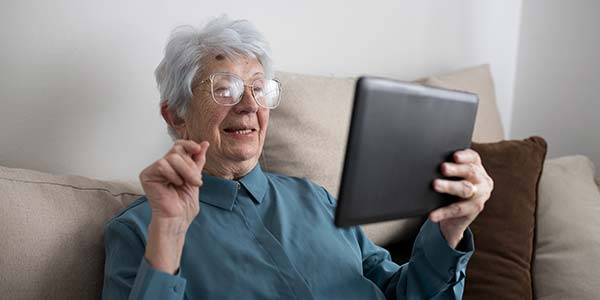 Independent Old Woman with Tablet